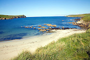 Coast Bigtown Wick between Scarfi Taing headland on St Ninian's island and Brecks of Bigtown on Mainland, Shetland Islands, Scotland