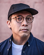 Alan Javillonar, co-owner of The Classroom, poses for a portrait with his favorite glasses outside of the store Friday September 25, 2015. His Oliver People Reeves glasses were made in Japan. (Michael Starghill, Jr.)