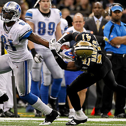 January 7, 2012; New Orleans, LA, USA; Detroit Lions wide receiver Calvin Johnson (81) stiff arms New Orleans Saints safety Roman Harper (41) during the 2011 NFC wild card playoff game at the Mercedes-Benz Superdome. Mandatory Credit: Derick E. Hingle-US PRESSWIRE