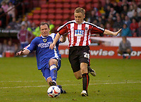 Photo: Glyn Thomas.<br />Sheffield Utd v Cardiff City. Coca Cola Championship.<br />29/10/2005.<br />Cardiff's Kevin Cooper (L) battles for the ball with Derek Geary.