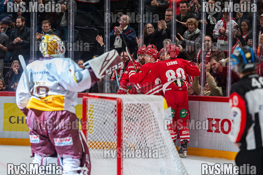 LAUSANNE, SWITZERLAND - NOVEMBER 23: #81 Ronalds Kenins of Lausanne HC celebrates his goal with teammates during the Swiss National League game between Lausanne HC and Geneve-Servette HC at Vaudoise Arena on November 23, 2019 in Lausanne, Switzerland. (Photo by Monika Majer/RvS.Media)
