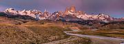 Alpenglow, pre-dawn light, Cerro Torre (centre) and FitzRoy from FitzRoy river, La Quinta estancia on edge Parque Nacional Los Glaciares, Patagonia, Argentina.