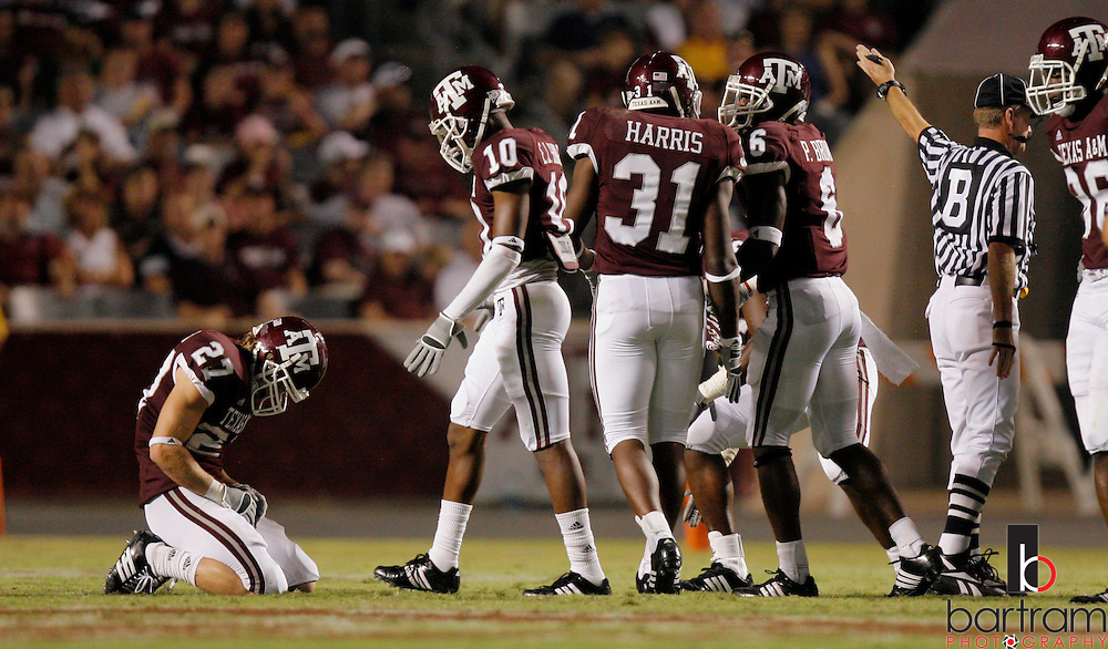 Texas A&M punt returner Jordan Peterson, left, kneels on the field after fumbling a punt that was recovered by Montana State during the third quarter on Saturday, Sept. 1, 2007. Texas A&M won the game 38-7 at Kyle Field in College Station, TX.
