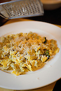 Ravioli al plin with sage-butter sauce and grated parmesan cheese (parmigiano-reggiano) at an Italian restaurant in La Morra, Italy.