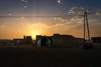 Men from a Sudanese Berber community in Merzouga perform a traditional dance during a four day wedding celebration.