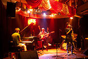 Jazz band plays at JZ Club on Fuxing Lu in Shanghai, China. Following the popularity of other jazz and blues clubs in Shanghai, Like the popular and nearby Cotton Club, J Z Club is as busy as it can be on the main nights of th week, full of Shanghainese and ex-pat customers, this is just one venue which makes up Shanghais flourishing bar scene.
