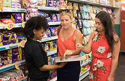 EDITORIAL USE ONLY<br /> Shopper Katherine Gardner (left) and Chelsea Fumarola are some of the first to try a chocolate bar called 'Twin Peaks' , as it launches at Poundland in Camden, London.