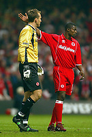 Photo: Scott Heavey.<br /> Middlesbrough v Bolton Wanderers. Carling Cup Final. 29/02/2004.<br /> George Boateng consoles his keeper, Mark Schwarzer after his blunder