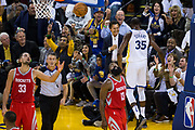 Golden State Warriors forward Kevin Durant (35) celebrates a basket with fan against the Houston Rockets at Oracle Arena in Oakland, Calif., on October 17, 2017. (Stan Olszewski/Special to S.F. Examiner)