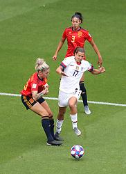 Spain's Maria Pilar Leon (left) fouls USA's Tobin Heath for a penalty