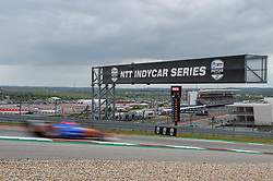 March 23, 2019 - Austin, TX, U.S. - AUSTIN, TX - MARCH 23: An IndyCar streaks by the NTT IndyCar Series sign coming out of turn 1 during the IndyCar afternoon qualifications at Circuit of the Americas on March 23, 2019 in Austin, Texas. (Photo by Ken Murray/Icon Sportswire) (Credit Image: © Ken Murray/Icon SMI via ZUMA Press)