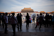 "Tourists and other visitors watching the beauty inside  ""The Forbidden City"" which was the Chinese imperial palace from the Ming Dynasty to the end of the Qing Dynasty. It is located in the middle of Beijing, China. Beijing is the capital of the People's Republic of China and one of the most populous cities in the world with a population of 19,612,368 as of 2010."
