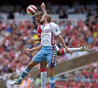 Photo: Daniel Hambury.<br />Arsenal v Aston Villa. The Barclays Premiership. 19/08/2006.<br />Arsenal's Thierry Henry and Villa's Olof Melberg battle.