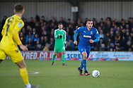 AFC Wimbledon defender Rod McDonald (4) dribbling and about to start and attack during the EFL Sky Bet League 1 match between AFC Wimbledon and Fleetwood Town at the Cherry Red Records Stadium, Kingston, England on 8 February 2020.