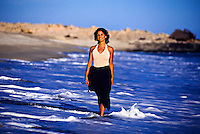 Mexican woman walking on the beach, Hotel Hacienda del Mar, Los Cabos, Baja California, Mexico