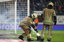 November 29, 2017 - Anderlecht, BELGIUM - A fireman removes fireworks from the pitch during a Croky Cup 1/8 final game between RSC Anderlecht and Standard de Liege, in Anderlecht, Wednesday 29 November 2017. BELGA PHOTO VIRGINIE LEFOUR (Credit Image: © Virginie Lefour/Belga via ZUMA Press)