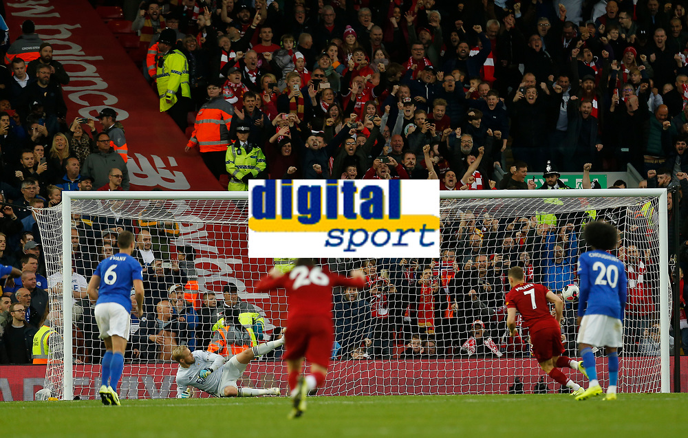 Football - 2019 / 2020 Premier League - Liverpool vs. Newcastle United<br /> <br /> James Milner scores from the penalty spot in added time to give his side a dramatic 2-1 win, at Anfield.<br /> <br /> COLORSPORT/ALAN MARTIN