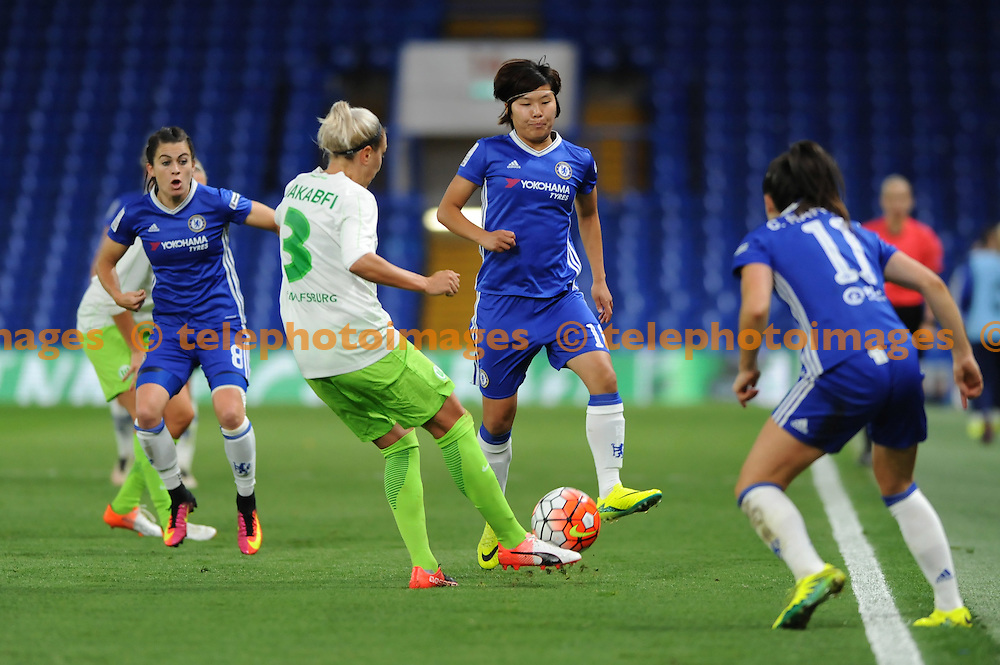 Chelseas Ji So-Yun and Wolfsburgs Zsanett Jakabfi in action during the UEFA Women's Champions League match between Chelsea and Wolfsburg at Stamford Bridge in London. October 5, 2016.<br />Holly  Allison / Telephoto Images<br />+44 7967 642437