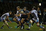 Tom James of Cardiff Blues is tackled by Ryan Wilson (l) of Glasgow Warriors.   Guinness Pro12 rugby match, Cardiff Blues v Glasgow Warriors Rugby at the Cardiff Arms Park in Cardiff, South Wales on Friday 16th September 2016.<br /> pic by Andrew Orchard, Andrew Orchard sports photography.
