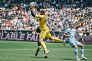 Los Angeles Galaxy goalkeeper Josh Saunders makes a save during the first half of an friendly soccer match against Manchester City, Sunday, July 24, 2011, in Carson, Calif. (AP Photo/Bret Hartman)