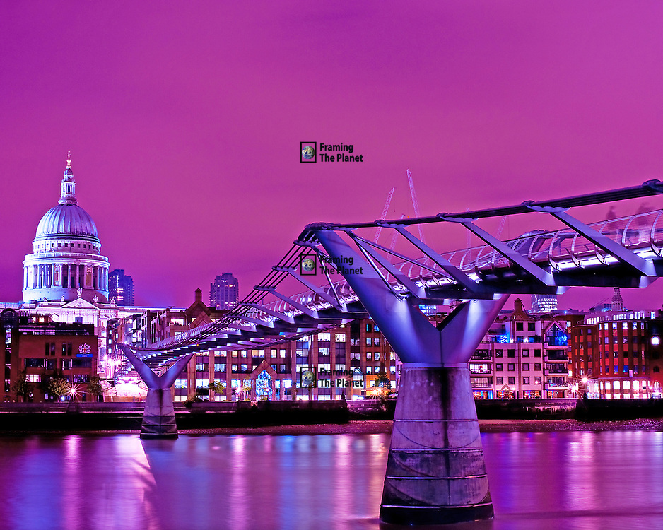 This is one of the most popular images I have produced and it happened almost by chance. I had began the evening in the City and walked back from the Royal Exchange to St Paul's photographing as I went. Once I had crossed the bridge I had intended stopping but decided to try one more shot from the river bank. I didn't even give this image much of a chance, I took only two or three exposures and left it at that. <br /> <br /> When I reviewed the images the next day I realised this would make on of the best images in my whole collection. This photo was taken just after sunset and we are treated an amazing wealth of colour and provides a view of the historic St Paul's Cathedral lined up with the Millennium Bridge as it crosses the river Thames in London. <br /> <br /> A stunning purple haze has been cast over the river and the cathedral and the lights on the opposite bank help to add character and detail to this great image.