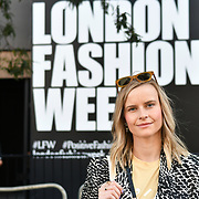 Fashionista attend London Fashion Week SS19 street photography at the Strand, London, UK. 17 September 2018.