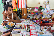 17 JUNE 2013 - YANGON, MYANMAR: A small newsstand in the Yangon-Dala ferry terminal in Yangon.  The Burmese newspaper industry has enjoyed explosive growth this year after private ownership was allowed in 2013. Private newspapers were shut down under former Burmese leader Ne Win in the early 1960s. The revitalized private press is a sign of the dramatic changes sweeping Myanmar, formerly Burma, in the last three years.      PHOTO BY JACK KURTZ