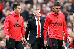 Manchester United caretaker manager Ole Gunnar Solskjaer (centre) walks off the pitch in the half time break during the Premier League match at Old Trafford, Manchester.