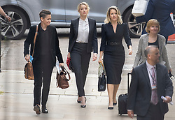 © Licensed to London News Pictures. 24/07/2020. London, UK. American actor AMBER HEARD (2L), Bianca Butti (L) and lawyer Jennifer Robinson (C) arrive at the High Court in London where Johnny Depp is in a legal dispute with UK tabloid newspaper The Sun over allegations he assaulted his former wife, Amber Heard. Photo credit: Peter Macdiarmid/LNP