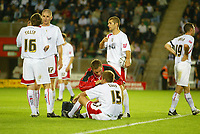 Photo: Marc Atkins.<br /> Milton Keynes Dons v Colchester United. Carling Cup. 22/08/2006. MK Don's Gareth Edds recieves medical attention.