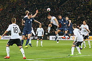 Lukas Podolski of Germany battles in the air with Chris Smalling of England during the International Friendly match between Germany and England at Signal Iduna Park, Dortmund, Germany on 22 March 2017. Photo by Phil Duncan.