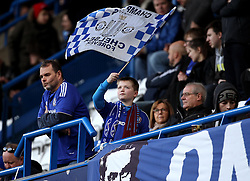 A young Chelsea fan waves a flag before the game against Scunthorpe United - Mandatory byline: Robbie Stephenson/JMP - 10/01/2016 - FOOTBALL - Stamford Bridge - London, England - Chelsea v Scunthrope United - FA Cup Third Round