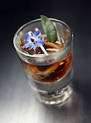 The oyster course in a shot glass (smoked duck/kimchee/mushroom) at EL Ideas restaurant on Wednesday, April 3, 2013. (Brian Cassella/Chicago Tribune)  B582828687Z.1 <br /> ....OUTSIDE TRIBUNE CO.- NO MAGS,  NO SALES, NO INTERNET, NO TV, CHICAGO OUT, NO DIGITAL MANIPULATION...