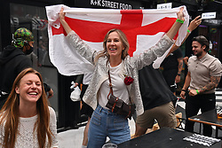 © Licensed to London News Pictures. 11/07/2021. London, UK. England supporters gather at Boxpark in Croydon, south London ahead of the EURO 2020 semi-final between England and Italy. Photo credit: London News Pictures