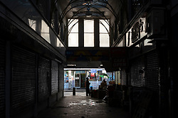 © Licensed to London News Pictures. 27/12/2020. London, UK. Londoners continue abrupt their daily business around Peckham Rye Lane as London continues to be placed in Tier 4 Covid-19 restrictions. Central government have planned to review the Tier rating before the New Year. Photo credit: Ray Tang/LNP