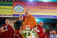 His Holiness the Dalai Lama waving to the crowd gathered at the Drepung Lachi Monastery courtyard as he arrives for the ceremony to award nuns the first Geshe-ma degrees at Drepung Lachi in Mundgod, Karnataka, India on December 22, 2016