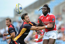 Aderito Esteves of Portugal passes the ball under pressure - Photo mandatory by-line: Dougie Allward/JMP - Mobile: 07966 386802 - 11/07/2015 - SPORT - Rugby - Exeter - Sandy Park - European Grand Prix 7s
