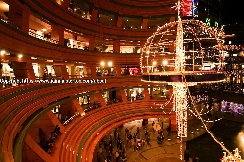 Modern architecture at night of Canal City shopping mall in Fukuoka Kyushu Japan