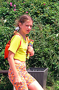 Girl age 13 walking with backpack and school supplies.  WestPlatte Poland