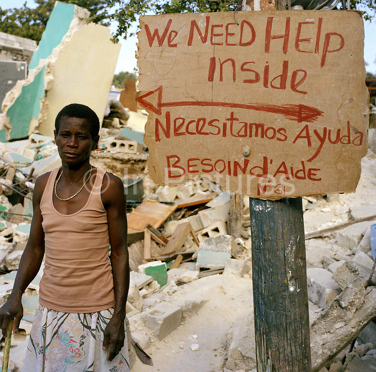 """All around Port Au prince are the hand painted signs and banners shown in the pictures, such was the desperation shortly after the earth quake. Many went without food and water for several days or more. The tragedy is that  it seems many of these requests went largely ignored. Theo , like many haitians is bemused """"We painted a sign saying we needed food and water in the hope that the aid agencies may be able to help, but no one has helped, not one person."""""""