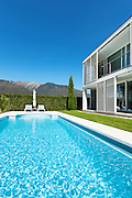 Modern villa with pool, view from the garden