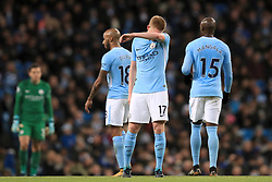 Manchester City's Kevin De Bruyne looks dejected after seeing his side concede