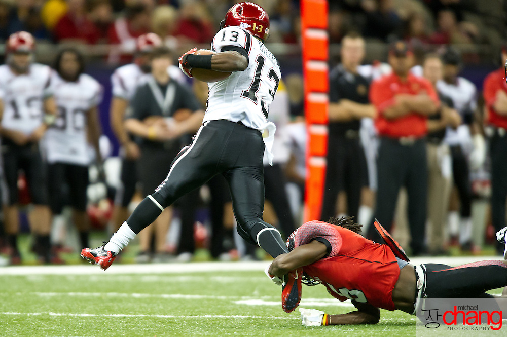 """Louisiana-Lafayette's Dwight """"Bill"""" Bentley CB (5) attempts to tackle San Diego State's RB Ronnie Hillman (13) during the R+L Carriers New Orleans Bowl at the Mercedes-Benz Superdome.  Louisiana-Lafayette defeated San-Diego State 32-30. (Copyright Michael Chang)"""