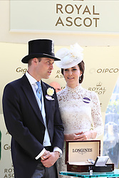 The Duke and Duchess of Cambridge await to present a trophy to the winner of the King's Stand Stakes during day one of Royal Ascot at Ascot Racecourse.