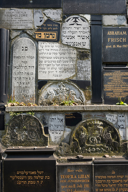 Krakow, Poland - September 2, 2016: Old gravestones in the New Jewish Cemetery in Kraków, Poland. The cemetery was founded in 1800 and is located in the historic Jewish neighborhood of Kazimierz. During World War II the Nazis sold or otherwise used the Jewish gravestones for other purposes. Following the war many gravestones were recovered and the cemetery renovated.