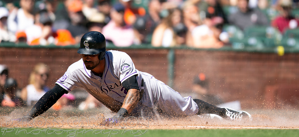 Sep 16, 2018; San Francisco, CA, USA; Colorado Rockies Ian Desmond slides safely home on a two-RBI single by Antonio Senzatela during the second inning of a Major League Baseball game at AT&T Park. Mandatory Credit: D. Ross Cameron-USA TODAY Sports