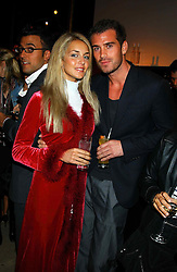 LADY ISABELLA HERVEY and MR SEAN MOORE at a party to celebrate the first 20 years of fashion label Donna Karan held at her store at 19/20 New Bond Street, London W1 on 21st September 2004.<br /><br />NON EXCLUSIVE - WORLD RIGHTS