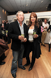 NICK & NETTE MASON at the TAG Heuer British Formula 1 Party at the Mall Galleries, London on 15th September 2008.