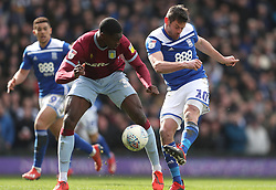 Burnley's Ashley Barnes (centre) in action