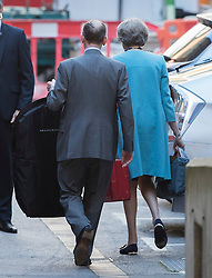 © Licensed to London News Pictures. 14/07/2016. London, UK. Prime Minister Theresa May walks to her car with her husband Philip as she leaves her old apartment before heading to Downing Street for her first full day in office. Photo credit: Peter Macdiarmid/LNP